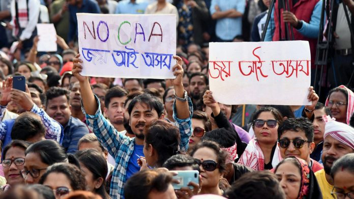 A December 2019 protest in Assam against a Modi government policy excluding Muslim refugees from citizenship. Photograph: Anuwar Hazarika/Reuters